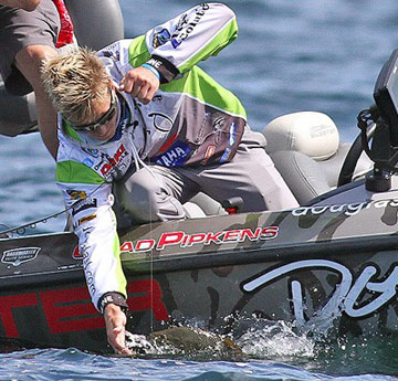 Chad Pipkens lands a smallmouth bass during the final of the 2013 St. Lawrence River Showdown. Photo credit: B.A.S.S./Steve Bowman