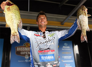 Chad Pipkens with 2 big Lake Erie smallmouth bass on stage at the Bassmaster Northern Open on his way to victory. Credit: James Overstreet